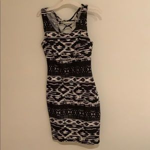 Black and white dress with detail on upper back.